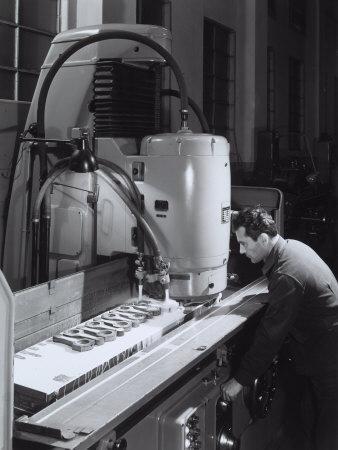 https://imgc.artprintimages.com/img/print/worker-operating-a-machine-in-the-ferrari-factory_u-l-q10t22l0.jpg?p=0