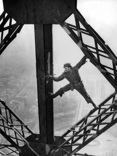 Worker Painting the Eiffel Tower--Photo