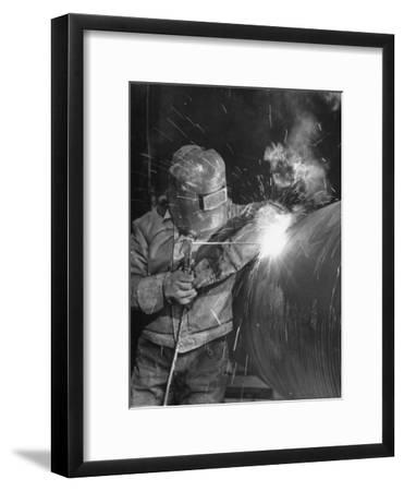 Worker Welding Pipe Used in Natural Gas Pipeline at World's Biggest Coal Fueled Generating Plant-Margaret Bourke-White-Framed Premium Photographic Print