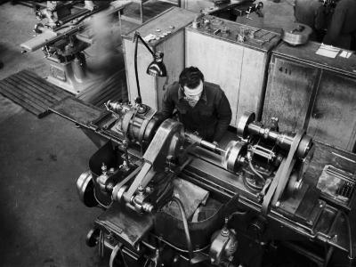 Worker Working at a Machine Inside the Innocenti Automobile Factory-A^ Villani-Photographic Print