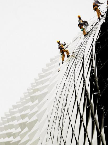 Workers Climb Down the Roof of Singapore's Spikey Fruit Shaped Esplanade Arts Center--Photographic Print