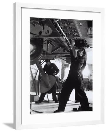 Workers During a Phase of the Construction of an Airplane at the Caproni Factory at Predappio-A. Villani-Framed Photographic Print