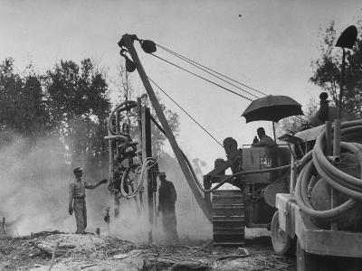 Workers From Gulf Interstate Gas Co. Laying Pipe to Be Used in Natural Gas Pipeline--Photographic Print