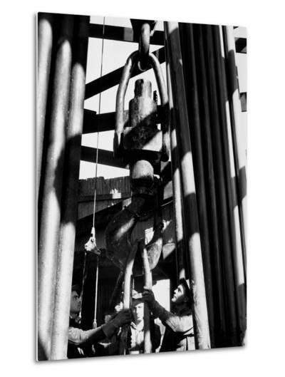 Workers Lower Pipe into Oil Well Inside Rig in a Texaco Oil Field-Margaret Bourke-White-Metal Print