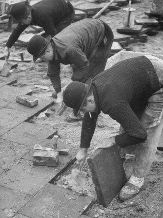 https://imgc.artprintimages.com/img/print/workers-paving-sidewalk-in-front-of-stalin-statue-are-making-highest-salaries-at-24-cents-per-hour_u-l-p44m1o0.jpg?p=0
