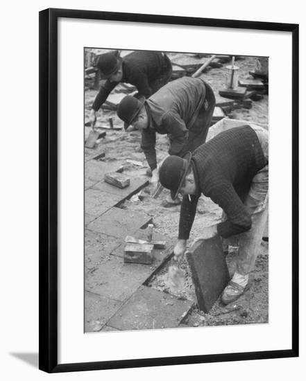 Workers Paving Sidewalk in Front of Stalin Statue Are Making Highest Salaries at 24 Cents Per Hour-Ralph Crane-Framed Photographic Print