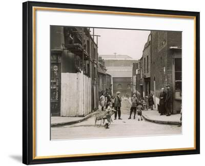Working Class Children Playing in a Cobbled Street in Wapping, East London--Framed Photographic Print