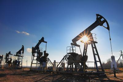 Working Oil Pumps Silhouette against Sun-Kokhanchikov-Photographic Print