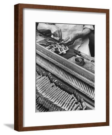Workman Installing Some of the Whippens, Shanks and Hammers at the Steinway Piano Factory-Margaret Bourke-White-Framed Premium Photographic Print