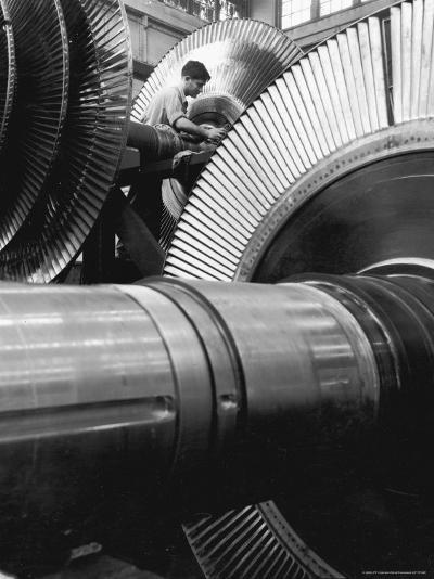 Workman on Large Wheel That Looks Like Fan, at General Electric Laboratory-Alfred Eisenstaedt-Photographic Print
