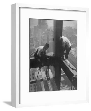 Workmen Attaching Steel Beams High Above Street During Construction of Manhattan Company Building-Arthur Gerlach-Framed Premium Photographic Print