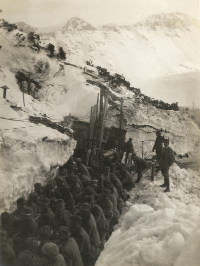 World War I: Soldiers in a Trench in the Snow Pulling a Gun--Photographic Print
