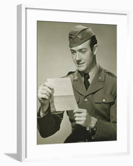 World War II Army Solider Reading Letter in Studio, Portrait-George Marks-Framed Photographic Print