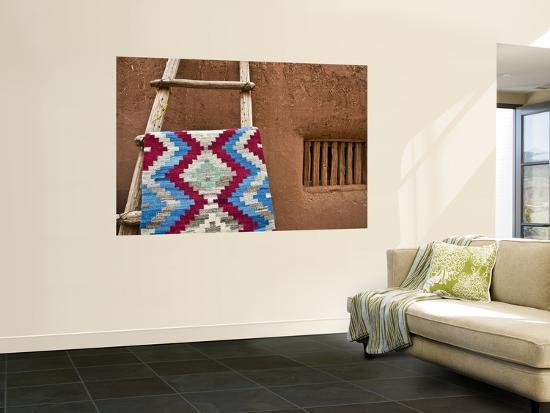 Woven Mat with Native American Indian Motif Against Mud-Brick Wall-Ray Laskowitz-Wall Mural