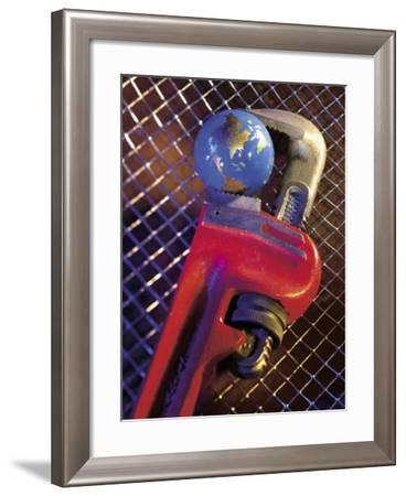 Wrench Holding Globe-Ellen Kamp-Framed Photographic Print