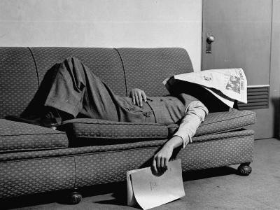 Writer Niven Busch Lying on Sofa with Newspaper over His Face as He Takes Nap from Screenwriting-Paul Dorsey-Photographic Print