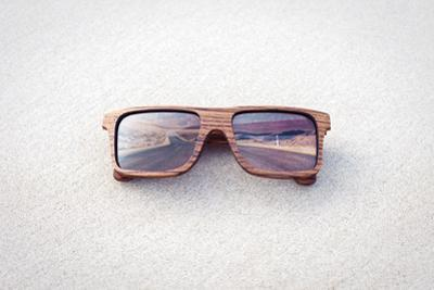 Double Exposure of Wooden Sunglasses and Desert Road by xcid