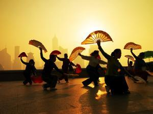Chinese Women Fan Dancing on the Bund Overlooking the Pudong District by xPacifica