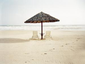 Couple of Deck Chairs with an Umbrella on a Beach in Vietnam by xPacifica