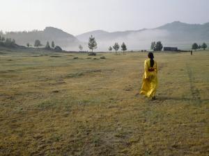 Female Shaman Walks across Grass in a Bright Yellow Silk Robe by xPacifica