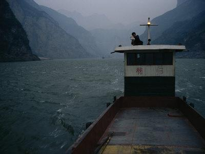 Man Changes a Lightbulb on a Barge near the Three Gorges