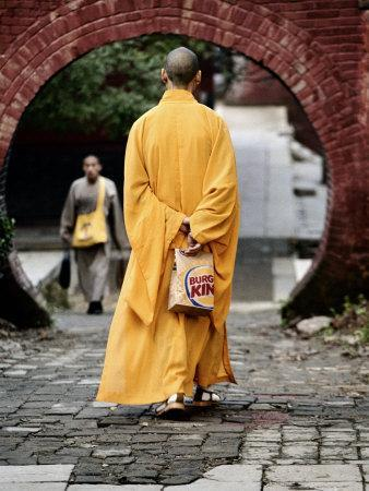 Monk at the Shaolin Temple Carries a Burger King Bag as He Walks