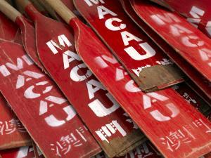 Stacked Oars Near Dragon Boats Ready for Use by Macau Team Members by xPacifica