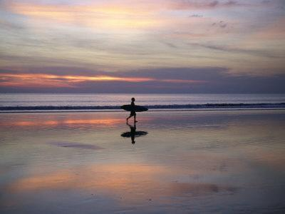Sunset on Kuta Beach, Surfers Carry their Surfboards from the Ocean