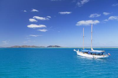 Yacht in Lagoon with Malolo Island, Mamanuca Islands, Fiji, South Pacific, Pacific-Ian Trower-Photographic Print