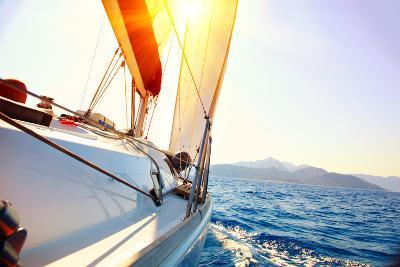 Yacht Sailing Against Sunset. Sailboat. Yachting. Sailing. Travel Concept. Vacation-Subbotina Anna-Photographic Print