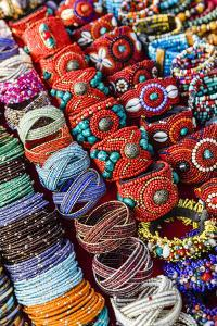 Detail of Bracelets and Rings at the Tibetan Market in Wednesday Flea Market in Anjuna, Goa, India by Yadid Levy