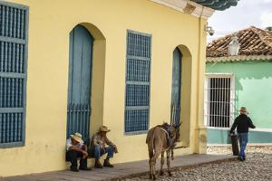 Elderly Men Sitting with Donkey at the Street, Trinidad, Sancti Spiritus Province by Yadid Levy