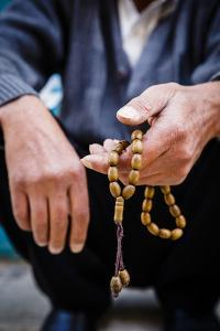 Hands Holding Worry Beads, Bethlehem, West Bank, Palestine Territories, Israel, Middle East by Yadid Levy