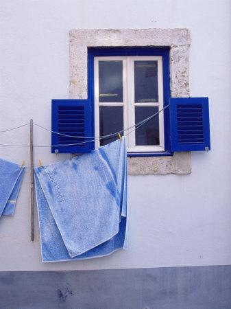 Laundry Hanging on Line at Window in the Moorish Quarter of Alfama, Lisbon, Portugal