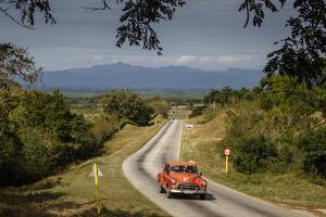 Old Vintage American Car on a Road Outside Trinidad, Sancti Spiritus Province, Cuba by Yadid Levy