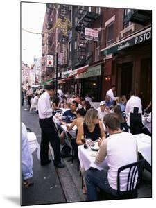 People Sitting at an Outdoor Restaurant, Little Italy, Manhattan, New York State by Yadid Levy