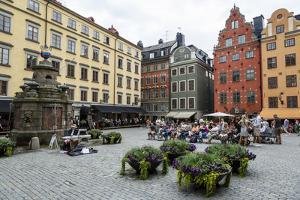 People Sitting at Stortorget Square in Gamla Stan, Stockholm, Sweden, Scandinavia, Europe by Yadid Levy