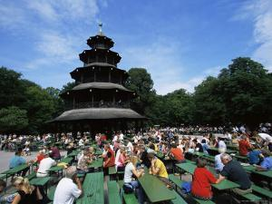 People Sitting at the Chinese Tower Beer Garden in the Englischer Garten, Munich, Bavaria, Germany by Yadid Levy