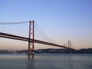 Ponte 25 De Abril Over the River Tagus, Lisbon, Portugal by Yadid Levy