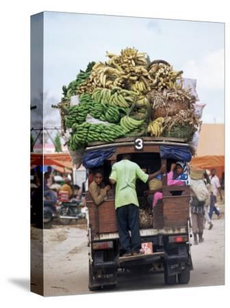 Van Loaded with Bananas on Its Roof Leaving the Market, Stone Town, Zanzibar, Tanzania