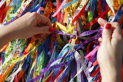 Woman Tying Lucky Ribbon at Igreja Nosso Senhor do Bonfim Church, Salvador, Bahia, Brazil