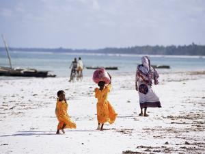 Young Girls and Their Mother Walking Along the Beach, Zanzibar, Tanzania, East Africa, Africa by Yadid Levy