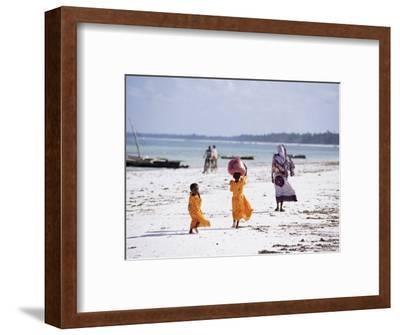 Young Girls and Their Mother Walking Along the Beach, Zanzibar, Tanzania, East Africa, Africa