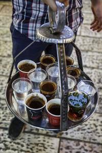 Young Man Holding a Tray with Coffee, Tea and Water in Old City, Jerusalem, Israel, Middle East by Yadid Levy