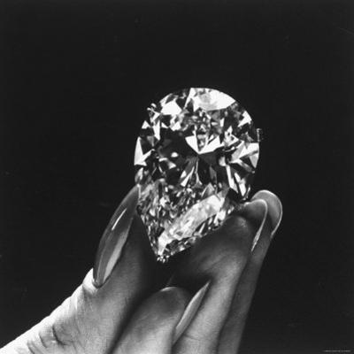 Actress Elizabeth Taylor Displaying Her Diamonds, Bought from Cartiers