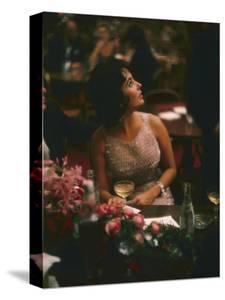 Actress Elizabeth Taylor in the Louis Sherry Bar, Metropolitan Opera Opening, New York, NY, 1959 by Yale Joel
