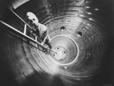 Admiral Hyman Rickover Descent Into Circular Nuclear Reactor Shell at Shipping Port Power Facility