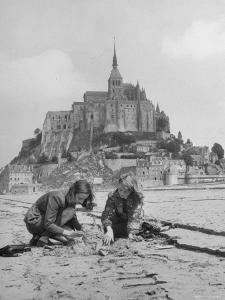 American Travelers Building a Sand Replica of France's Medieval Abbey at Mont Saint Michel by Yale Joel