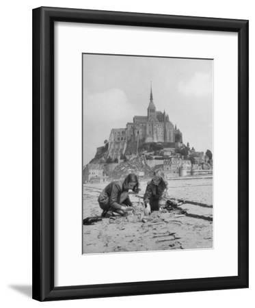 American Travelers Building a Sand Replica of France's Medieval Abbey at Mont Saint Michel