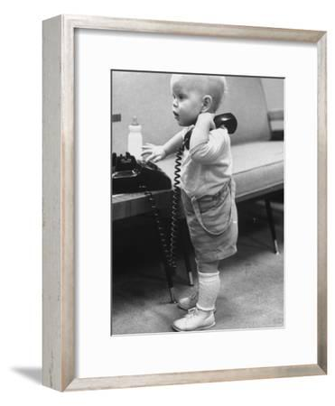 Baby Playing with a Telephone